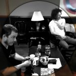 Listening to new tracks at County Q Studios. Photo by Skipp Frazier